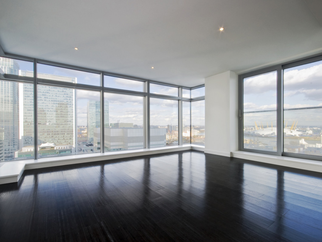 large corner office window with floor-to-ceiling windows and hardwood floors